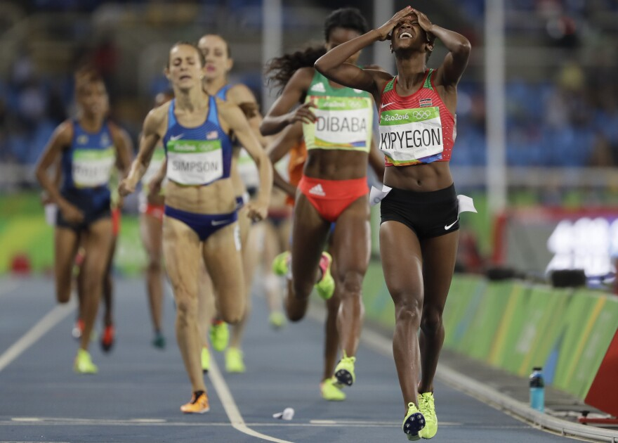 Kenya's Faith Kipyegon crosses the line to win the women's 1,500 meters. Kenya has won three distance races in the past three days.