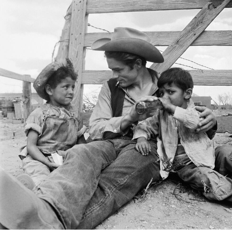 The 1956 film <em>Giant</em> was nominated for 10 Academy Awards and won a Best Director Oscar for George Stevens. Above, James Dean sits on set with Robert Marquez, left, and Joe Vasquez of Marfa, Texas.