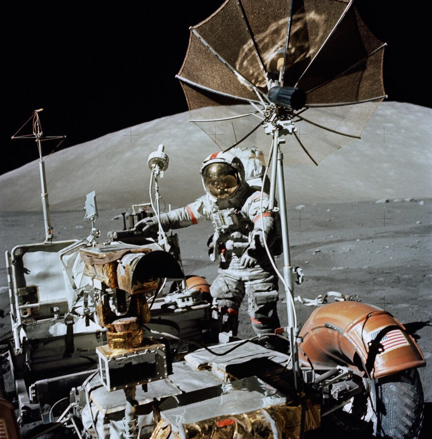 Astronaut Eugene A. Cernan, Apollo 17 commander, approaches the parked lunar roving vehicle on the lunar surface.