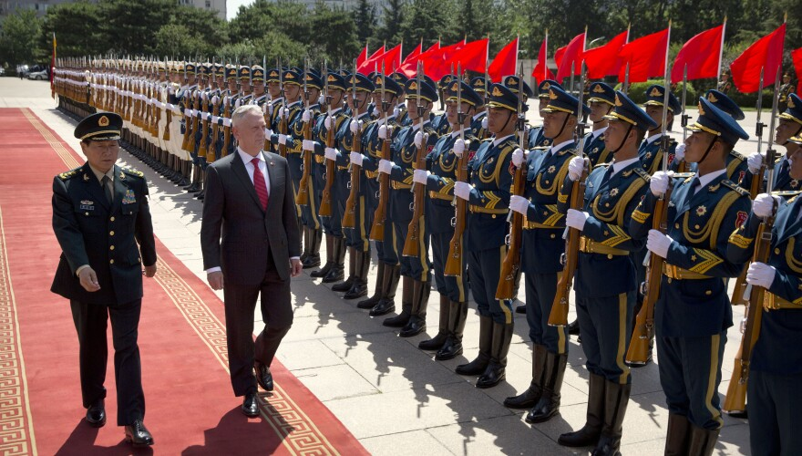 China's Defense Minister Wei Fenghe (left) and then-U.S. Defense Secretary Jim Mattis review an honor guard in Beijing in June 2018. Despite the increasing rivalry between the two countries, they still have top-level military contacts.