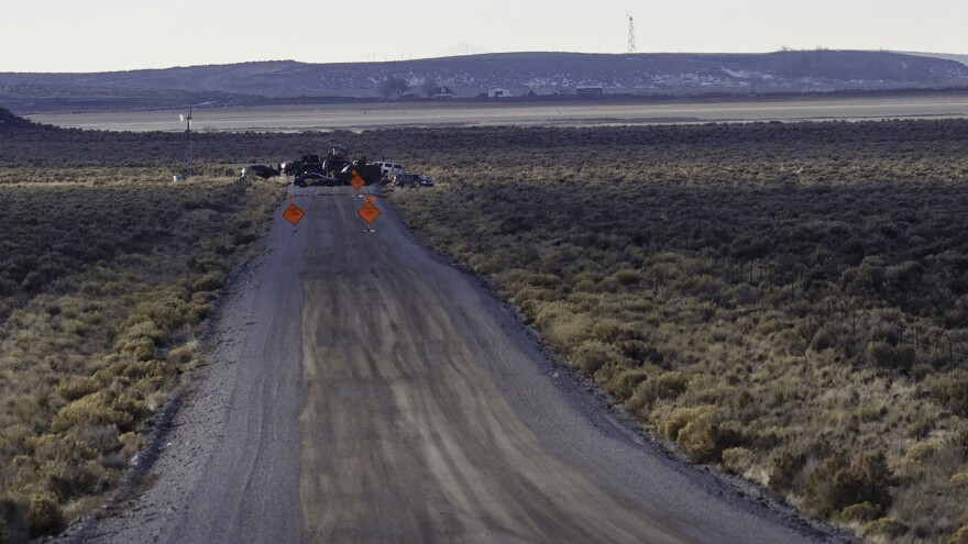 Police operate a checkpoint as part of a containment strategy around the Malheur Wildlife Refuge near Burns, Ore., on Wednesday. Although leaders of the group that occupied the federal site were arrested, armed militants remain at the refuge.