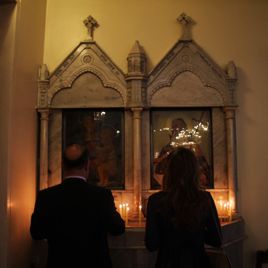 Two worshipers say prayers. Even amid Easter celebrations, Armenians in the Middle East remain apprehensive about the future.