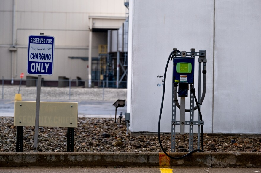 A vehicle charging station is seen in the parking lot of the Lordstown Motors vehicle body facility.