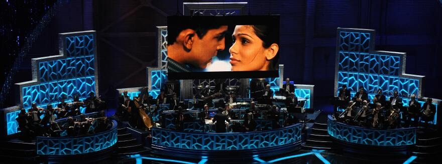 Musicians perform a song from <em>Slumdog Millionaire</em> during the 81st Annual Academy Awards on Feb. 22, 2009, in Hollywood, Calif. <em></em>The film won 8 Oscars including Best Picture that year — and had box office returns to show for it.