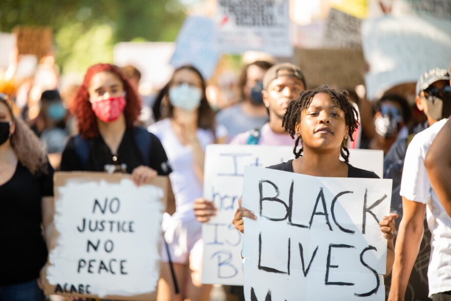 Demonstrators protest police brutality in Richmond, Va., in June.