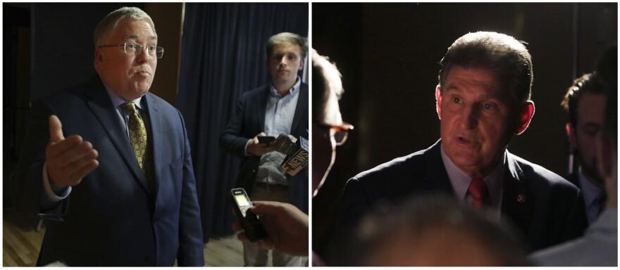 Patrick Morrisey, left, and Sen. Joe Manchin speak to reporters after a debate Thursday, Nov. 1, 2018, in Morgantown, W.Va.