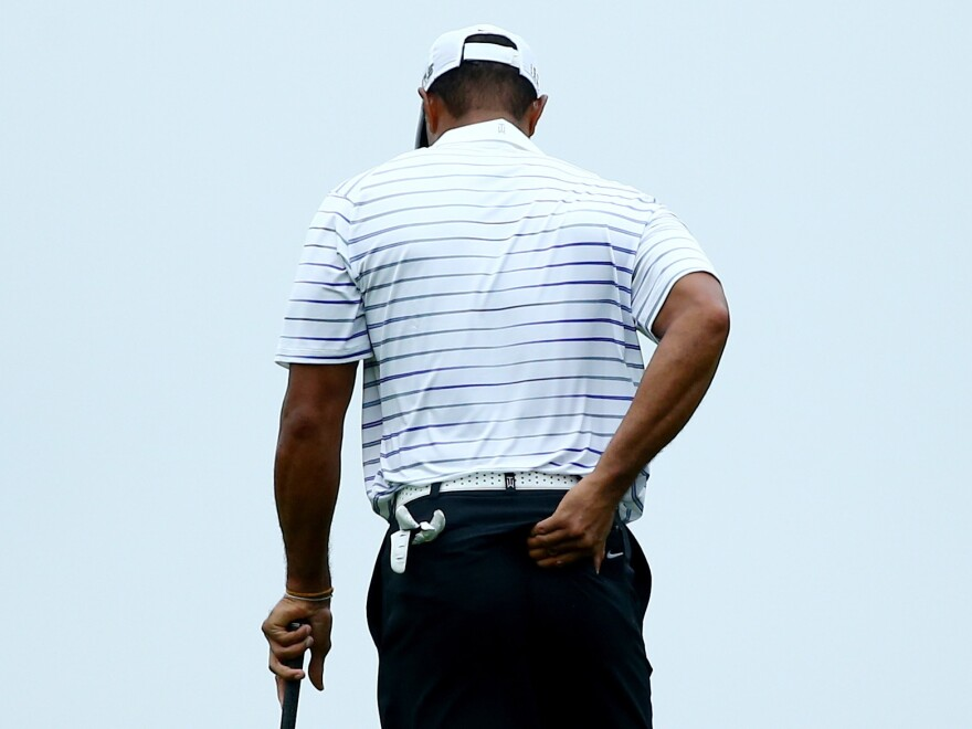 Tiger Woods rubs his back Aug. 8 during the second round of the 96th PGA Championship at Valhalla Golf Club in Louisville, Ky.
