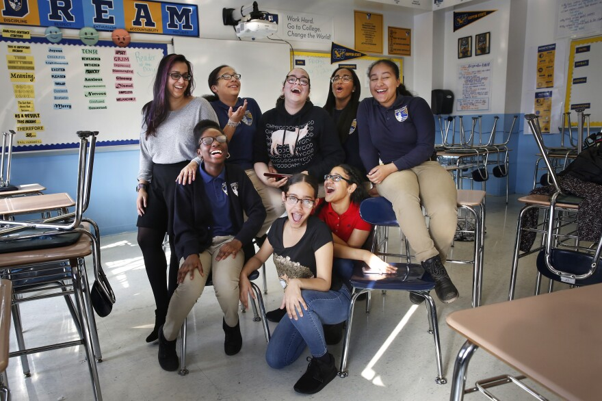 """English teacher Shehtaz Huq and the eighth-graders at Bronx Prep Middle School behind the winning podcast """"Sssh! Periods."""""""