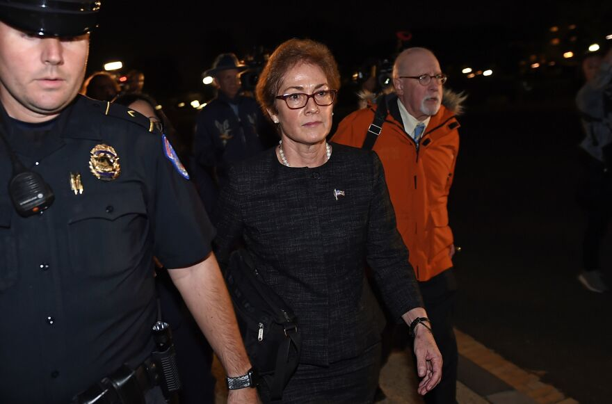 Former U.S. Ambassador to Ukraine Marie Yovanovitch, flanked by lawyers, aides and Capitol police, leaves the Capitol on Oct. 11 after testifying behind closed doors to the House Intelligence, Foreign Affairs and Oversight committees as part of the ongoing impeachment investigation into President Trump.