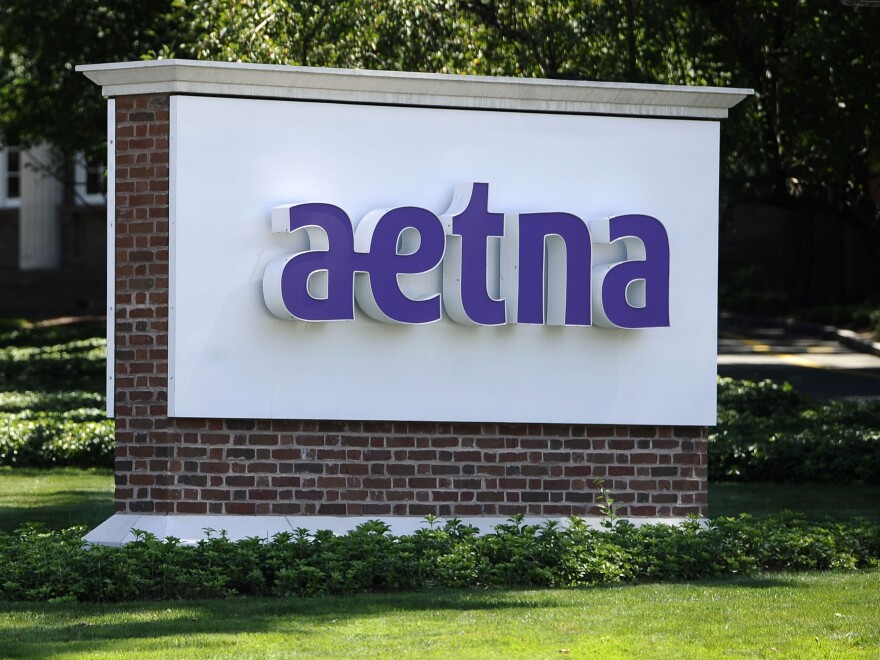 A federal judge has ruled against Aetna's proposed merger with its rival, Humana.