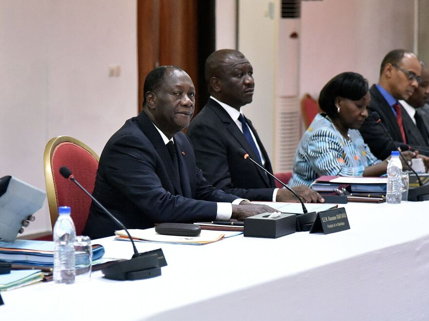 Ivorian President Alassane Ouattara chairs an extraordinary cabinet meeting in the resort town of Grand Bassam on March 16, 2016.