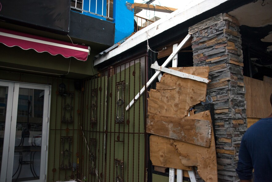 Before the hurricane, Sanchez tried to cover up the walls with plywood. It helped salvage the ironwork and glass doors but he has no idea where his patio fence went.