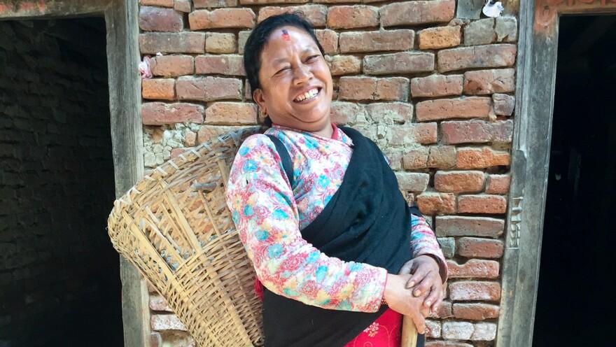 Tara Devi, who's around 45, says working makes her happy.
