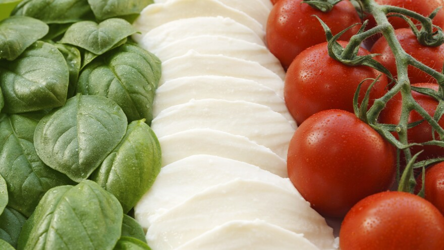The Italian flag made up of three ingredients that help form the base of the country's cuisine: basil, mozzarella and tomatoes.