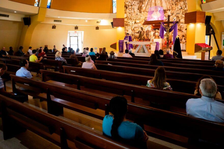 Parishioners at Santuario Nacional de Nuestra Señor de la Caridad in Miami practice social distancing at Mass.