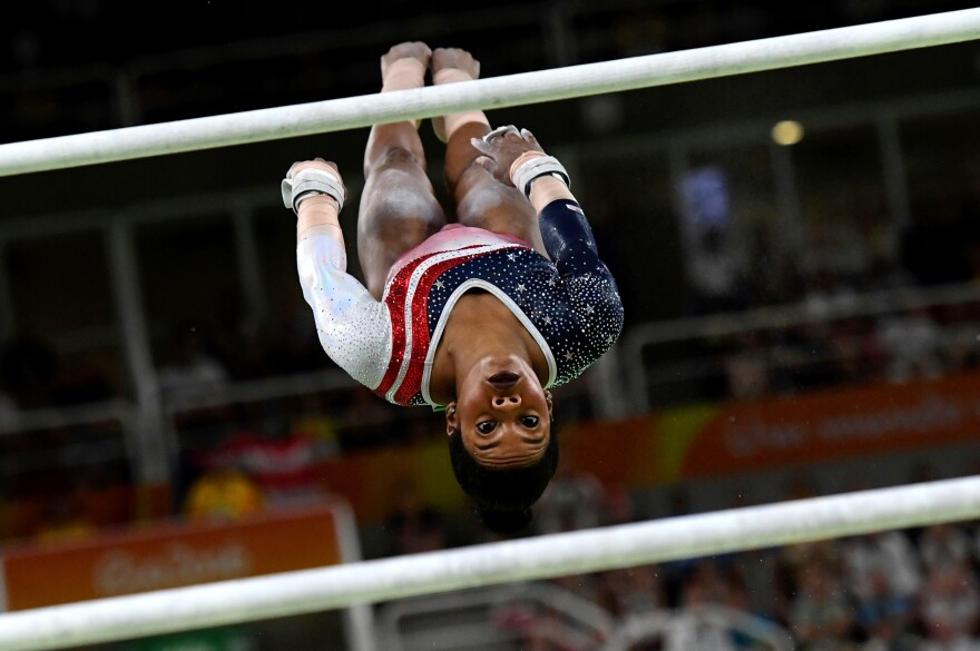 Gabby Douglas of the United States competes in the uneven bars during the women's team final.