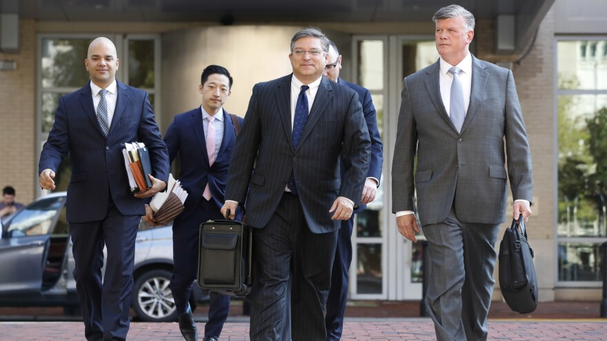 The defense team for Paul Manafort, including Kevin Downing (right) and Jay Nanavati (far left) walks into federal court on Thursday. After prosecutors rest, as they're expected to do Friday, the defense will have a chance to call witnesses and make its case.