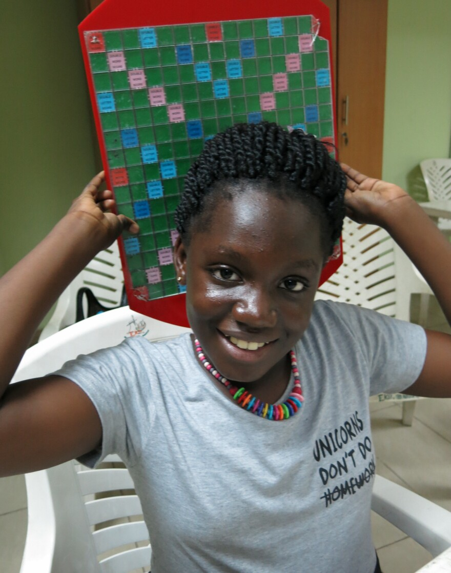 "Angela ""I'm not very shy!"" Osaigbovo, 10, of Nigeria came in second in a recent youth tournament and triumphed at Scrabble camp in August. She'd hoped to win the MSI World Youth Scrabble Championship in Lille, France, this weekend, but was denied a French visa."