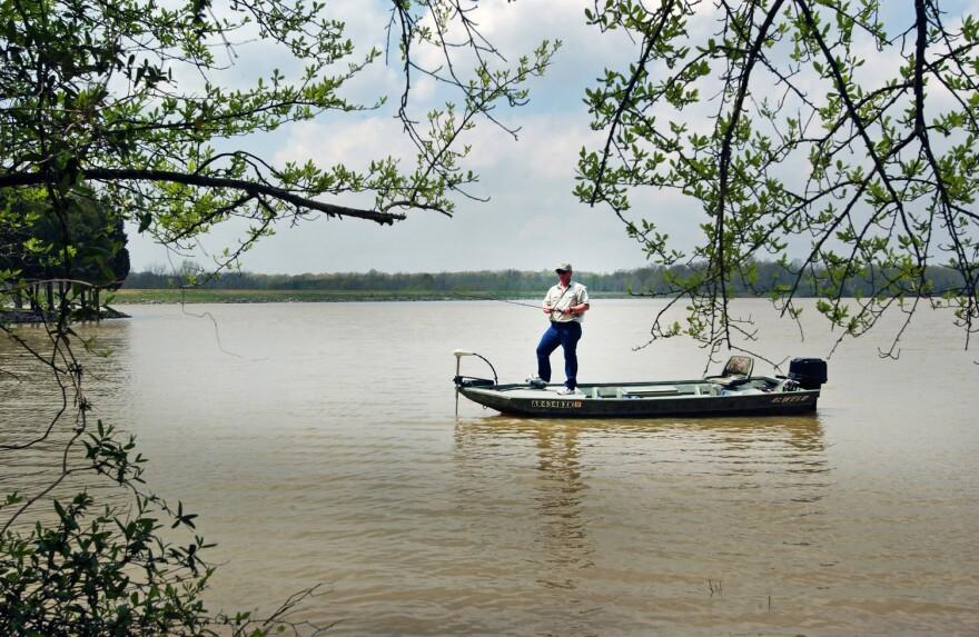 A man fishing on Lake Frierson at Lake Frierson State Park.