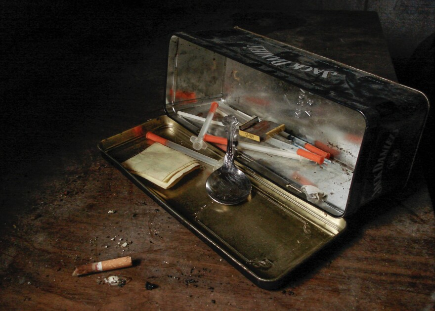 Syringes, spoon, and case.
