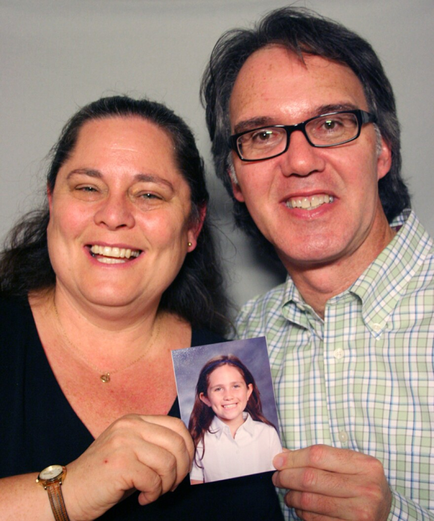 Robin Share and Rami Aizic hold a photo of their daughter, Bailey, at a visit to StoryCorps in Santa Monica, Calif.