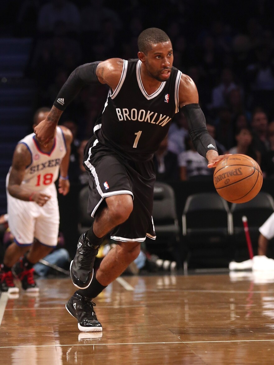 C.J. Watson of the Brooklyn Nets dribbles upcourt in a preseason game against the Philadelphia 76ers. The New York City borough finally has a pro sports team to call its own, says Frank Deford.