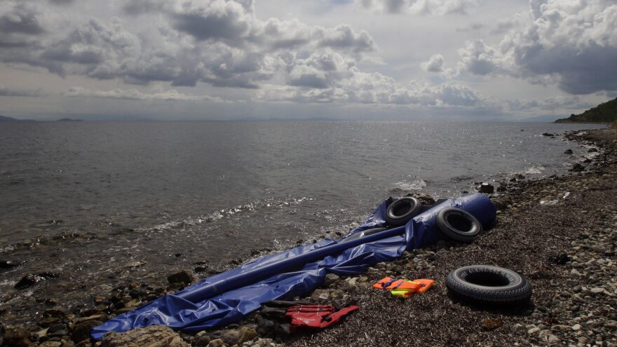 The remains of an inflatable boat that passed illegally from the coast of Turkey rest in October 2014 on the shore 10 miles from Mytilene, Greece. Thirty-four immigrants from Syria, among them one woman and three children, made a dangerous night journey Sept. 26.