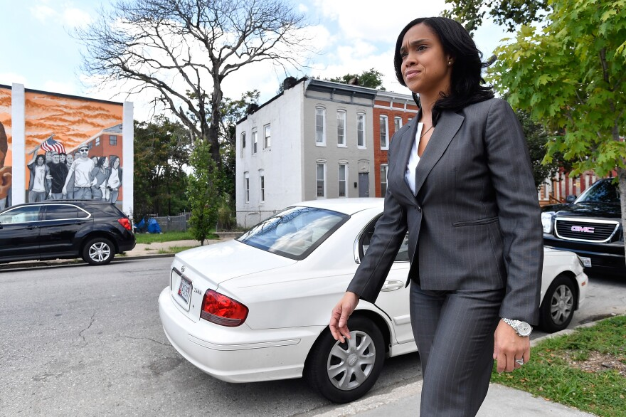 Baltimore State's Attorney Marilyn Mosby walks through a city neighborhood on August 24, 2016.