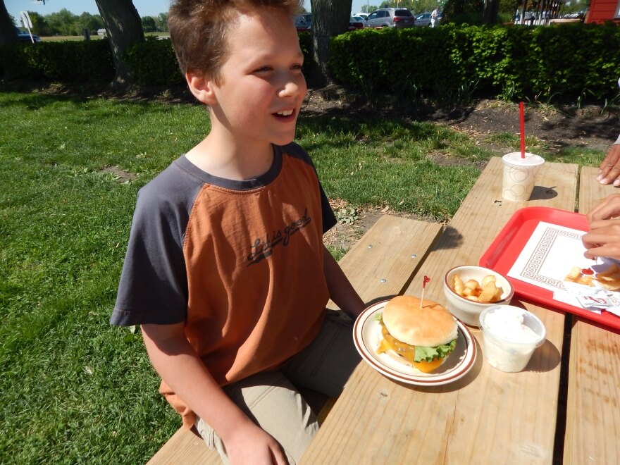 Felix Dakota is happy with a kids' burger and fries from Young's Jersy Dairy.