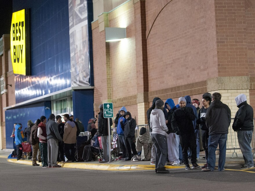 Customers wait in line Thursday at a Best Buy store in Richfield, Minn., to buy the PlayStation 4, which went on sale early Friday.