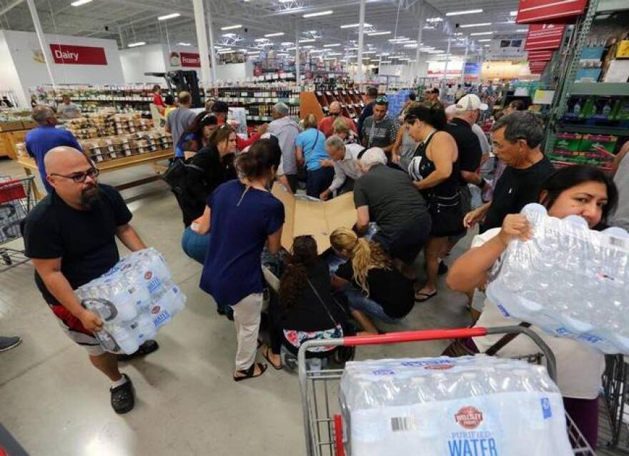 Shoppers in South Florida stock up on ice, water and other emergency supplies, part of a rare, statewide rush to prepare for Hurricane Irma.