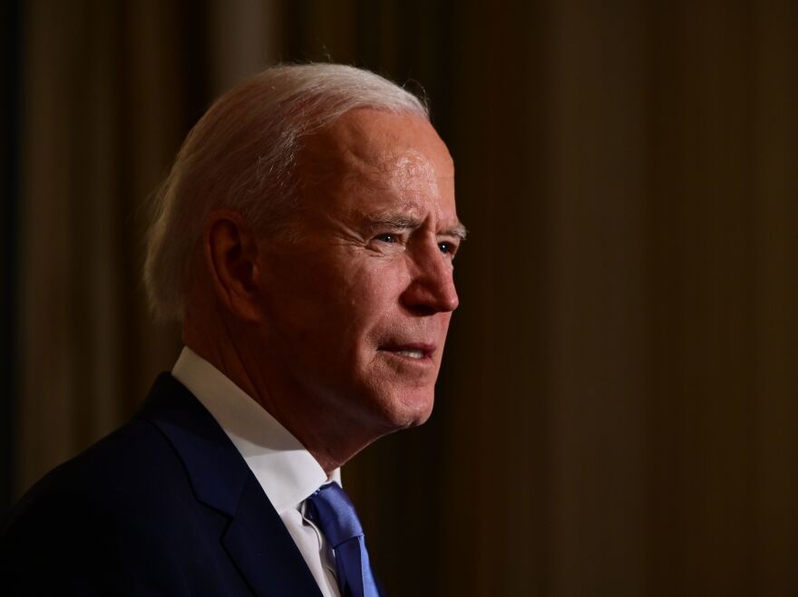 President Joe Biden swears in presidential appointees during a virtual ceremony in the State Dining Room of the White House on Wednesday. Data on Thursday showed new claims for state unemployment benefits reached 900,000, showcasing the weakening jobs picture in the country.