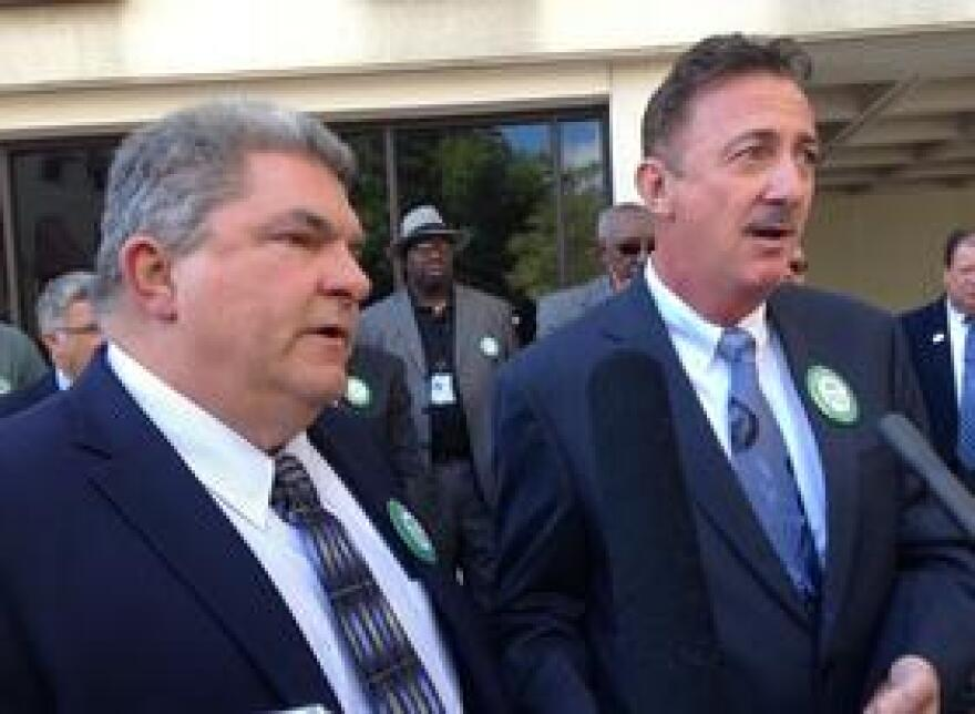 Lou Minardi and Rick Versace speak to reporters during Ground Transportation Day at the Capitol.