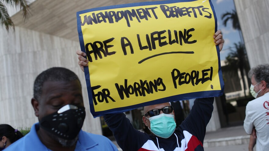 On Thursday in Miami Springs, Fla., demonstrators ask senators to support the continuation of boosted unemployment benefits.