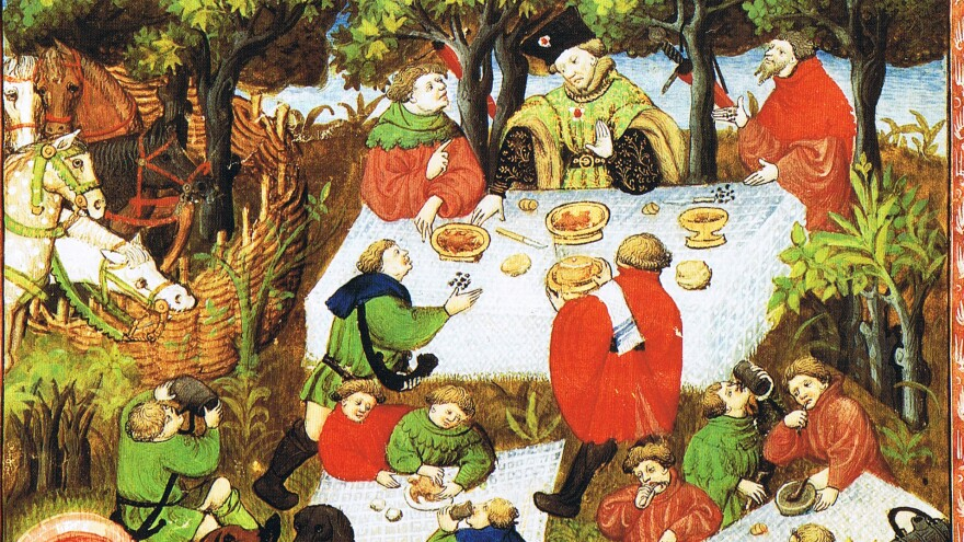 An illustration of noblemen enjoying a picnic, from a French edition of <em>The Hunting Book of Gaston Phebus</em>, 15th century.