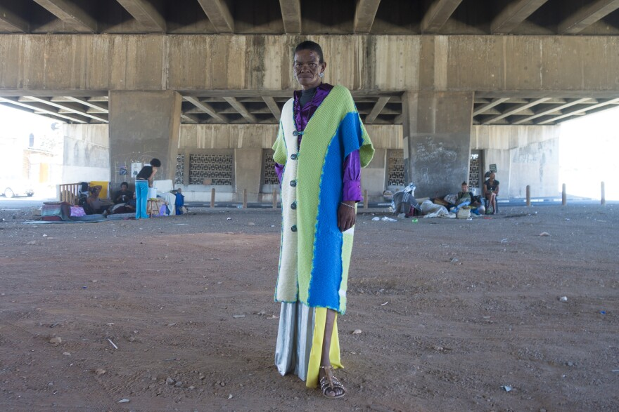 A transgender woman who goes by Joan Collins, 60, poses under the bridge in Cape Town where she and a group of transgender sex workers live.