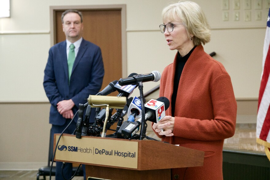 SSM Health President and CEO Laura Kaiser addresses reporters March 13 while St. Louis County Executive Sam Page looks on. Regional leaders announced restaurants will be limited to takeout, curbside and delivery orders.