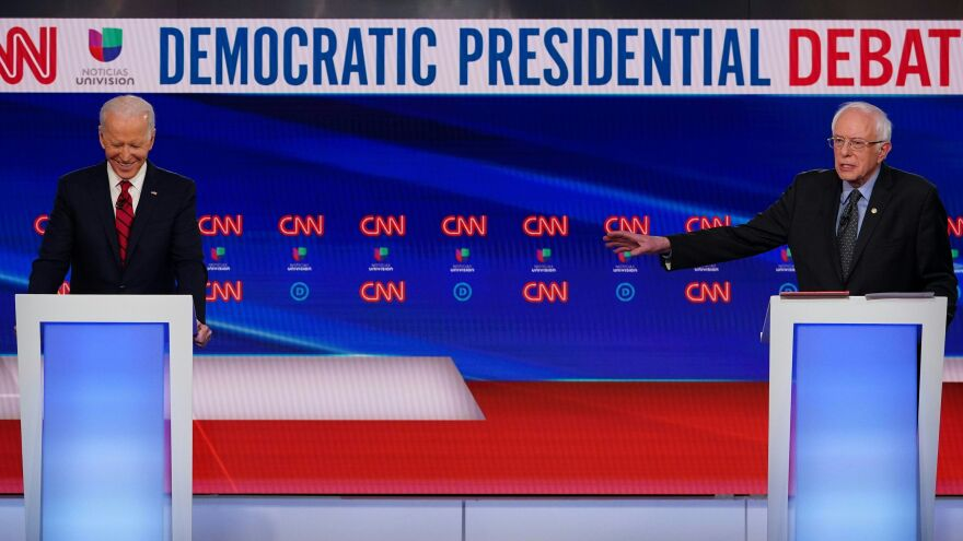 Joe Biden and Bernie Sanders take part in a Democratic primary debate on March 15. After Biden wrapped up the presidential nomination, the two formed joint task forces to formulate policy recommendations on six big issues.