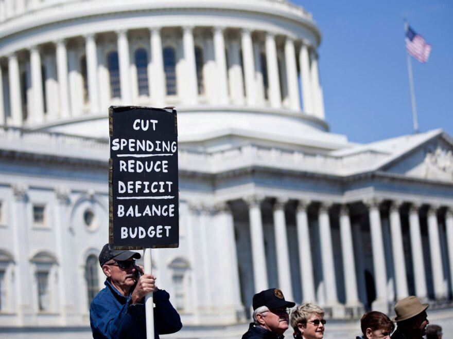 Tea Party activists gather on Capitol Hill on Wednesday. The federal government is facing a potential shutdown if Congress and the White House are not able to agree on a budget.