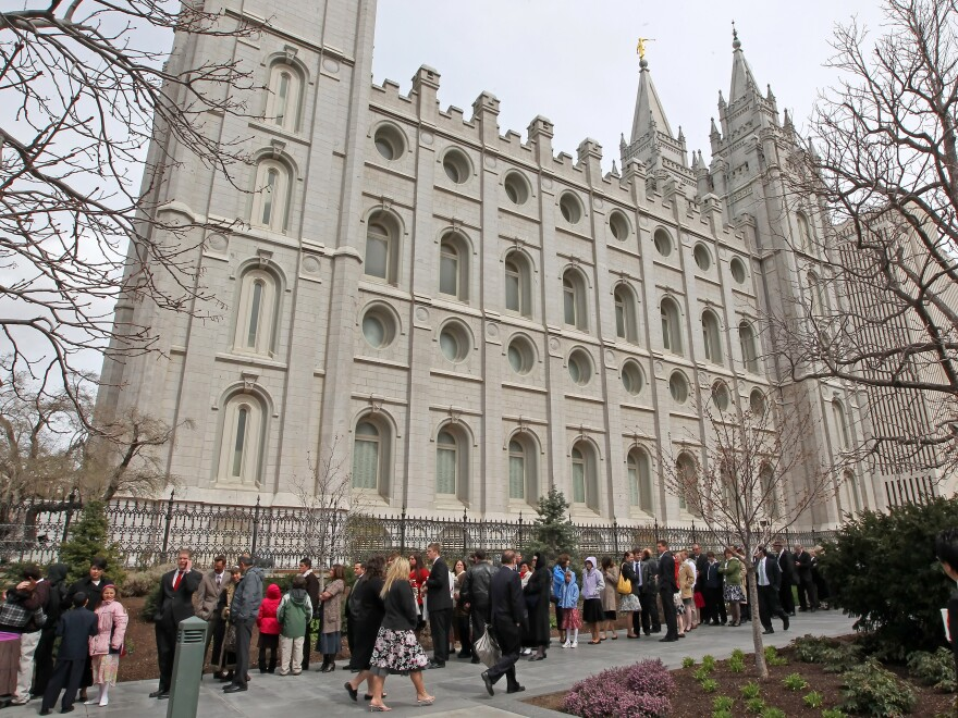 Mormons line up outside the historic Salt Lake Temple before the church's general conference in 2010.