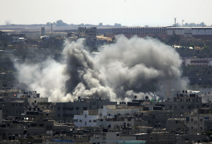 Smoke rises over Gaza City on Friday as Israel and Gaza militants resumed cross-border attacks after a three-day truce expired.
