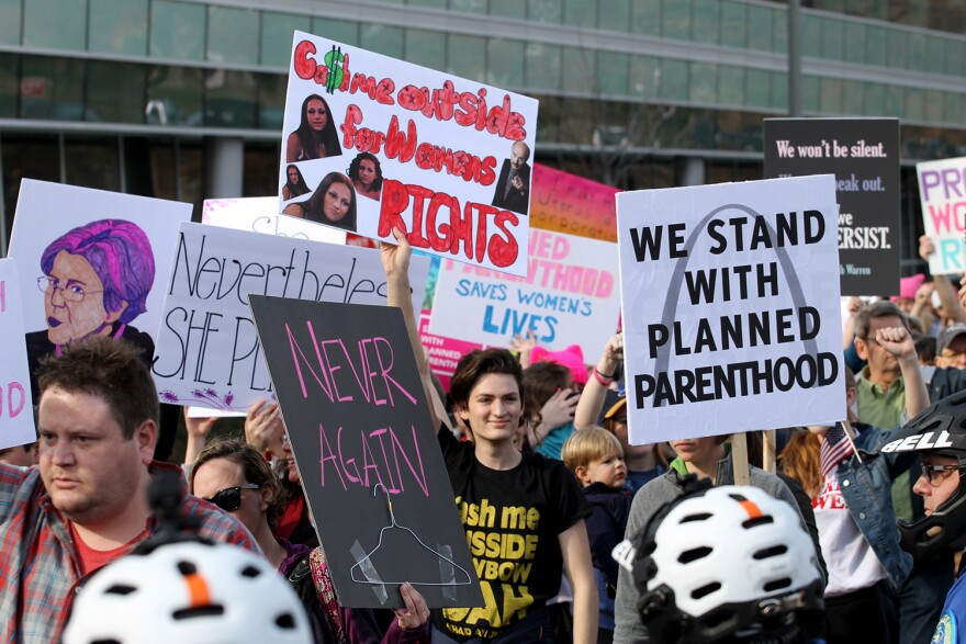 Planned Parenthood supporters marched silently past the organization's Central West End clinic as anti-abortion activists prayed during a 2017 demonstration.
