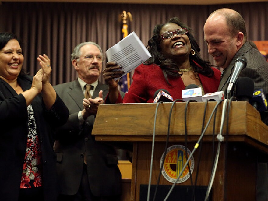 Michelle King is introduced by the school district board member and president, Steve Zimmer, right, as the new superintendent.
