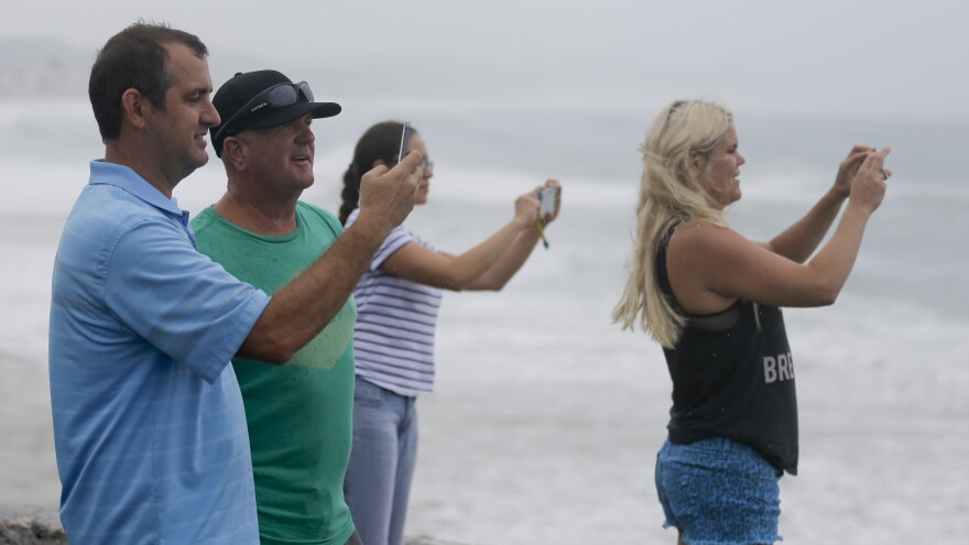 People take photos of the sea in Los Cabos, Mexico, on Sunday ahead of Hurricane Odile's landfall.