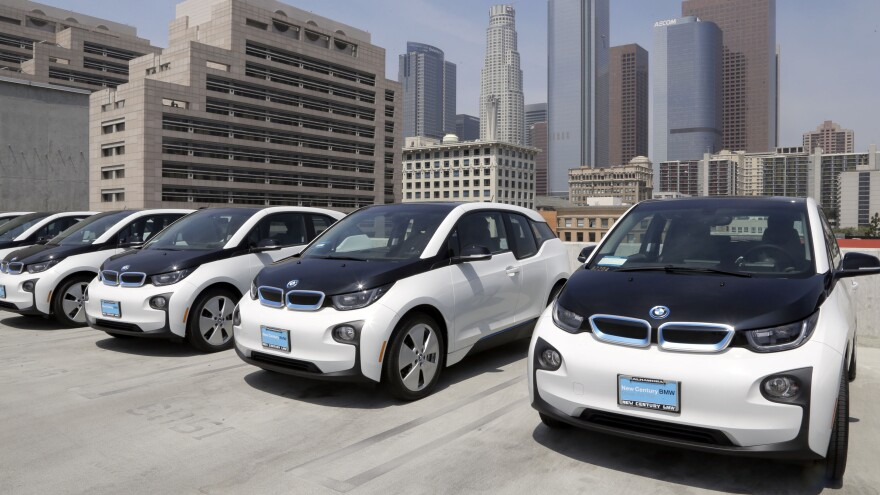 Electric cars are parked at the Los Angeles Police Department in 2016. California's latest plan for to fight climate change includes renewable energy and putting millions of electric cars on the road.