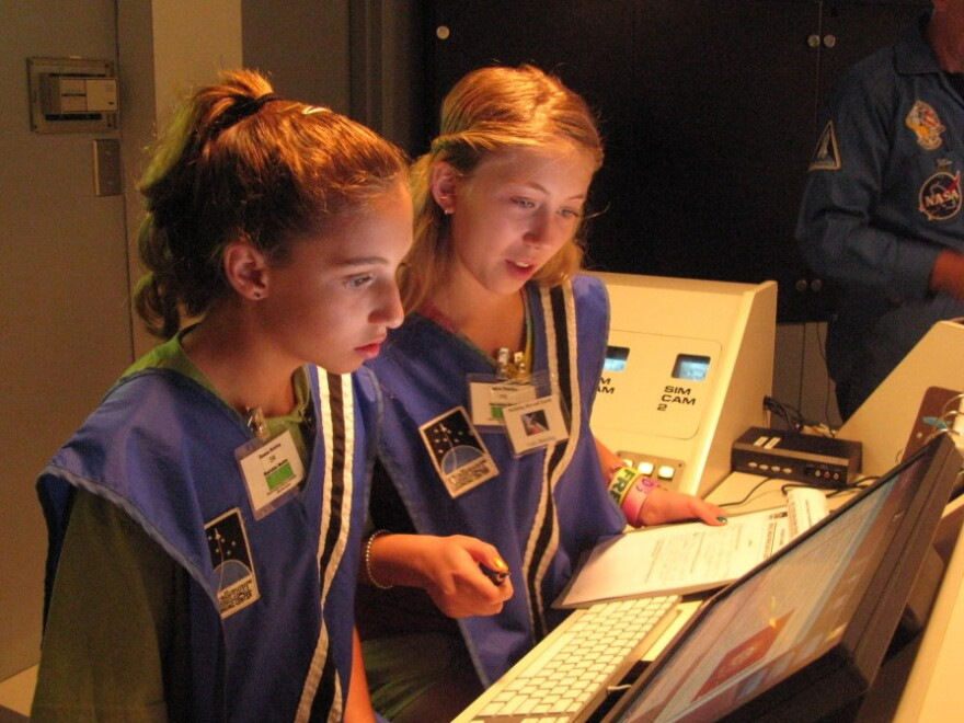 """Seventh-graders Sophie  Maloro (left) and Unity Bowling """"fly"""" a mission to Mars, part of a summer program at the MathScience  Innovation Center in Richmond, Va."""