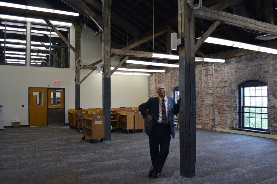 Tim Kambitsch, the library's executive director, looks up at the wood ceiling in the fourth floor flexible space.