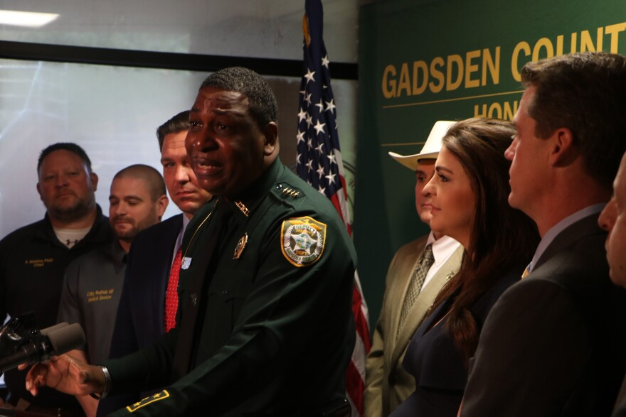 Gadsden County Sheriff Morris Young speaks at a press conference Thursday, March 5, 2020, flanked by Gov. Ron DeSantis, left, and First Lady Casey DeSantis