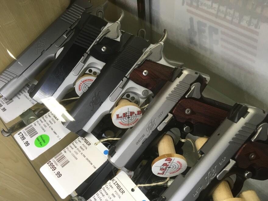 A rack of automatic handguns on display at a gun store in northwest Columbus.
