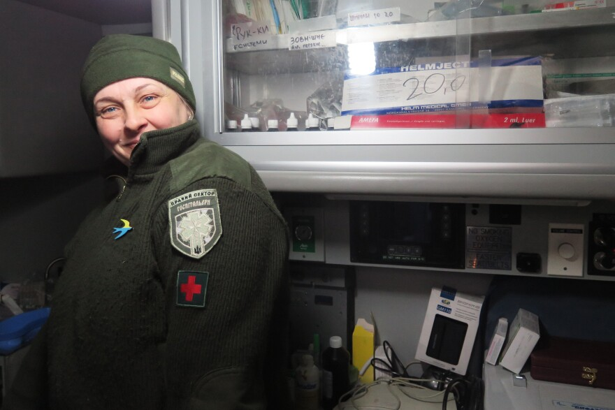 """Mama,"" like many members of the Right Sector militia in Ukraine's Pisky village, goes only by her nickname.  She stands inside the donated American ambulance that serves as a medical station for wounded troops."